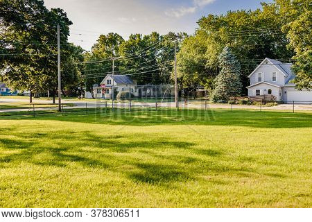 Small Park With A Baseball Diamond That Has A Grass Infield