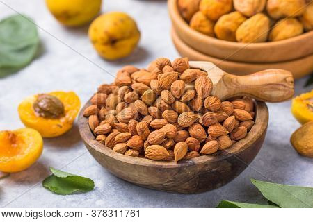 Handful Of Peeled Apricot Kernels On Light Background. Handful Of Peeled Apricot Kernels