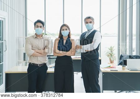 Portrait Multi-ethnic Male And Female Business Group Everyone Is Wearing A Medical Mask. Smile And L