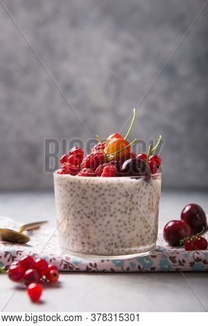 Chia Pudding With Cherry, Raspberry, Currant In Glass Bowl. \nhealthy Breakfast Concept And Idea - C