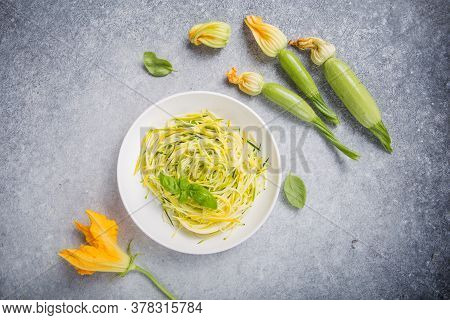 Zucchini Vegetable Noodles - Green Zoodles Or Courgette Spaghetti On Plate Over Gray Background. Cle