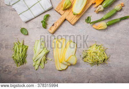 Variety Zucchini Vegetable Noodles - Green Zoodles Or Courgette Spaghetti On Plate Over Gray Backgro