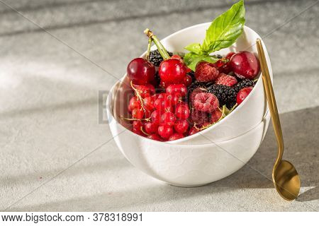 Bowl Of Fresh Berries On Grey Background. Natural Hard Light. Bowl Of Fresh Berries