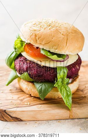 Veggie Beet  Burgers With Vegetables And  Greek Sauce. Healthy Food Concept. Veggie Beet  Burgers Wi