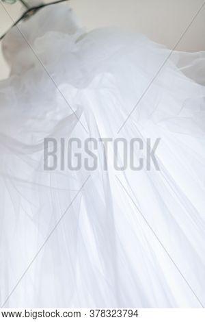Abstract Overhang Wedding Dress. Unusual Upward Angle View
