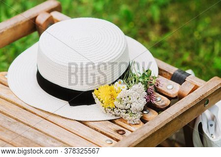 Cotton Wicker Hat And Eco Bag Near Wooden Deck Chair