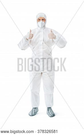 Doctor In Protective Medical Suit Showing Thumbs Up. Success Concept. Full Length Portrait Isolated