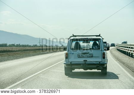 Russia, Crimea, September 11, 2019: An Old Retro Car On A New Road In Crimea. The Road To Tauris In