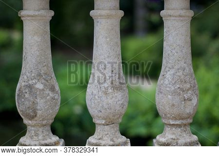 Stone Balustrades Against Soft Green Background With Space For Copy