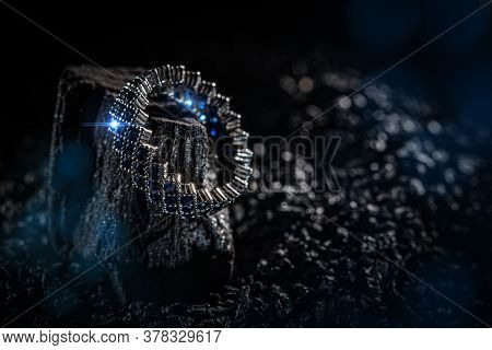 Ring Of The Jewelry With Blue Stones On Dark Background