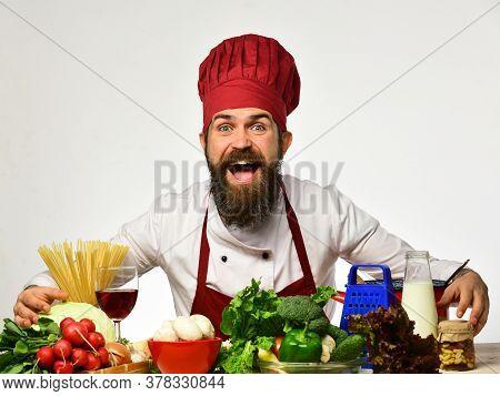 Chef Prepares Meal. Man With Beard Pretends To Hug Ingredients