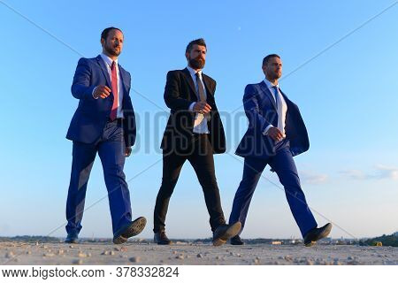 Businessmen With Confident Faces In Formal Suits And Ties