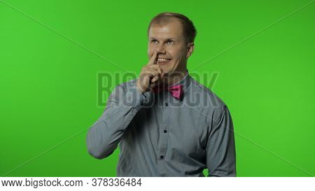 Funny Stupid Man Picking Nose With Silly Brainless Humorous Expression, Removing Boogers, Uncultured
