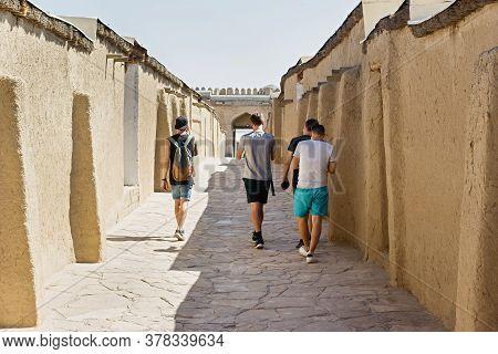Turkestan, Kazakhstan - 04 August 2019. Tourists Near The Medieval Mausoleum Of Khoja Ahmed Yasawi I