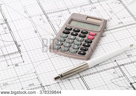 Calculator With Pen On Architectural House Building Blueprint Plan Background, Real Estate Or House