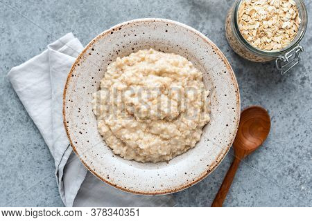 Plain Oatmeal Porridge In Bowl. Healthy Vegan Vegetarian Breakfast Food, Whole Grain Porridge Oats