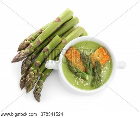 Delicious Asparagus Soup With Rusks Isolated On White, Top View