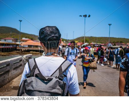 Chonburi/thailand - 20 Apr 2019:backpacker On Koh Lan Harbor In Pattaya City.bali Hai Pier The Harbo