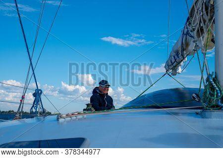 Stylish Captain On His Own Yacht. Russia, Tatarstan, July 25, 2020.