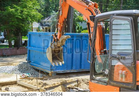 Group Of Excavator Working On A Construction Site Mini Excavator And Trash Container Construction Du