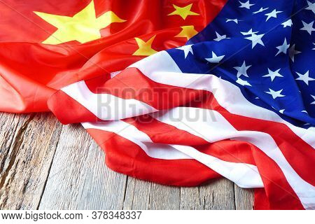 Usa Flag With China Flag. Chinese Flag And American Flag On The Wooden Table.