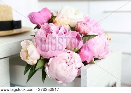 Bouquet Of Beautiful Peonies In Commode Drawer Indoors