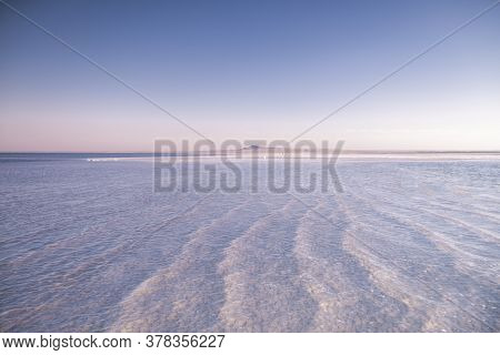 Nature Beautiful Sunset On The Lake. Salt Lake In The Astrakhan Region. Clear Water. Pink Sunset Lan