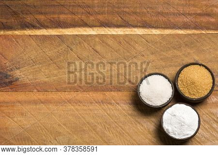 Sweetener Stevia And Sugar - Wooden Background