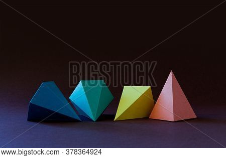 Multicolor Geometric Abstract Still Life Background. Bright Prism Pyramid Triangle Shape Figures On