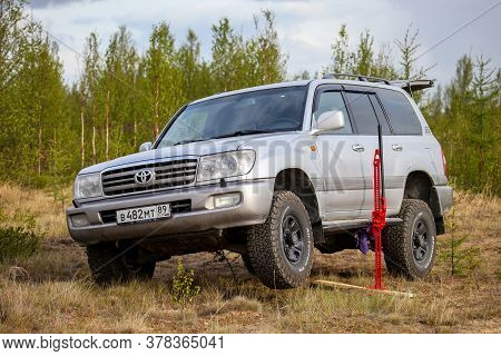Novyy Urengoy, Russia - June 2, 2020: 4x4 Car Toyota Land Cruiser 100 Lifted With The Hi-lift Jack.
