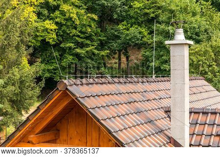The Roof Of A Family House With A Chimney And A Lightning Conductor. Lightning Protection. Detail Of