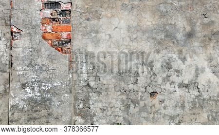 Grunge background with texture of old brick wall and cracked stucco of gray color. Mock up template. Copy space for text