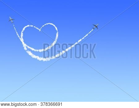 Two aircrafts draw a heart in the sky. Flight route of aircraft in shape of a heart. Love concept for traveling the world. Copy space for text