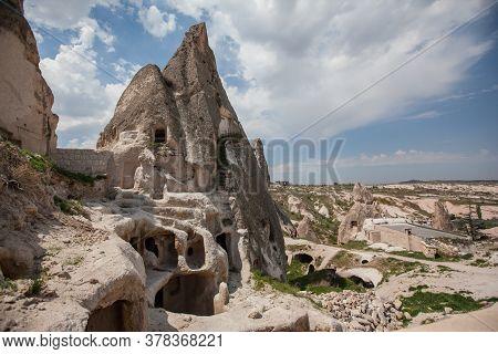 Cappadocia Tuff Formations Ancient Cave Town. Summer Landscape. Goreme Valley, Turkey