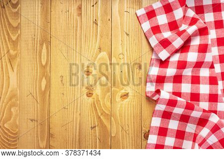 cloth napkin at old wooden board table background, top view
