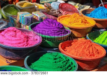 Hampi, India- January 1, 2019: Aromatic powder of different colors are sold during Hindu festival of Holi in Hampi, India