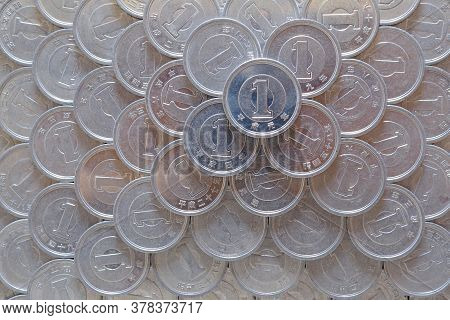 Field Of Japanese Coins At 1 Yen. Background Or Wallpaper. News About The Economy, Finances And Inte
