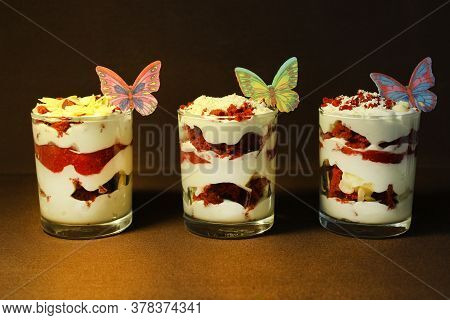 In A Transparent Container Strawberry Ice Cream Is Decorated With A Slice Of Strawberry