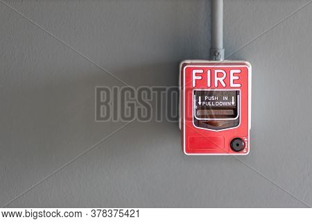 Fire Alarm Box On Cement Wall For Warning And Security System In The Condominium Place. Standard Saf
