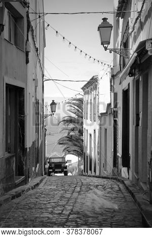 Old street in Icod de los Vinos town, Tenerife, Canary Islands. Black and white urban photography
