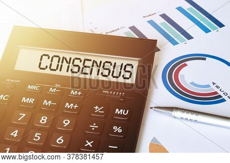 Word Consensus On Calculator. Business And Finance Concept.
