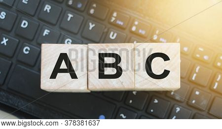 Wooden Blocks Abc On Computer Keyboard. Computer Literacy Education Concept