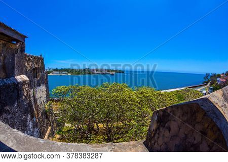 Medieval fortification in Mombasa, Kenya. Fort Jesus - fortress with five bastions. Corner bastion and loopholes. The concept of historical, educational and photo tourism