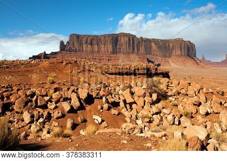 USA. Magnificent rainbow across the sky. Monument Valley is unique geological formation. Huge masses of red sandstone - outliers on the Indian Navajo Reservation. Concept of photo tourism