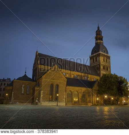 Riga Cathedral At Cathedral Square During Evening Blue Hour, Doma Laukums, Riga, Latvia. Aerial Pano