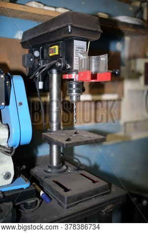Drill Press With A Drill Inserted. Metal Drilling