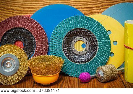 Set Of Abrasive Tools And Sandpaper On Vintage Wooden Background