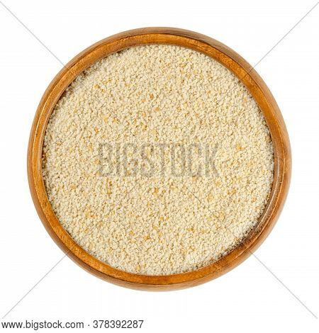 Fine Breadcrumbs In A Wooden Bowl. Dry Bread Crumbs, Known As Breading Or Crispies, Are Sliced ​​res