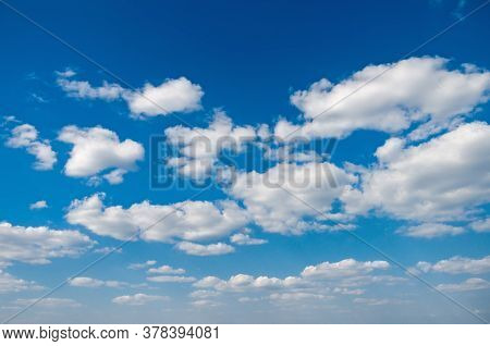 Azure Blue Cloudy Sky With White Cumulus Clouds On A Spring Bright Day