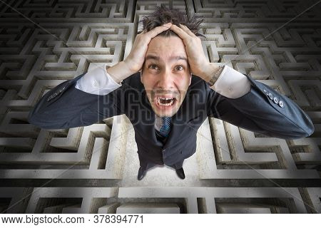 Young Man Is Confused And Lost In Maze. 3d Rendered Illustration Of Maze.